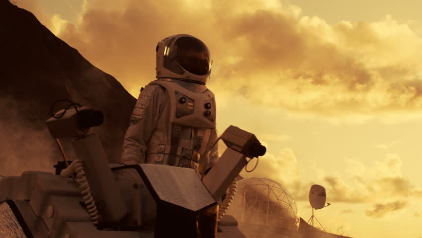First Astronaut On the Mars, Checking His Rover and Exploring Site near His Base/ Research Center. Space Travel/ Exploration, Colonization. Shot on RED EPIC-W 8K Helium Cinema Camera.