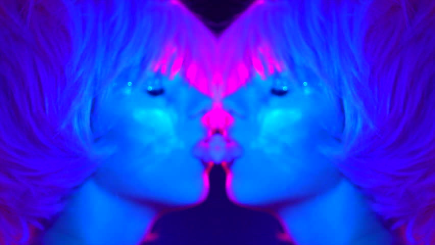 Fashion art portrait of beauty model woman in bright lights with colorful smoke. Smoking girl, Close up of a female inhaling from an electronic cigarette. Night life concept. 4K UHD Slow motion video