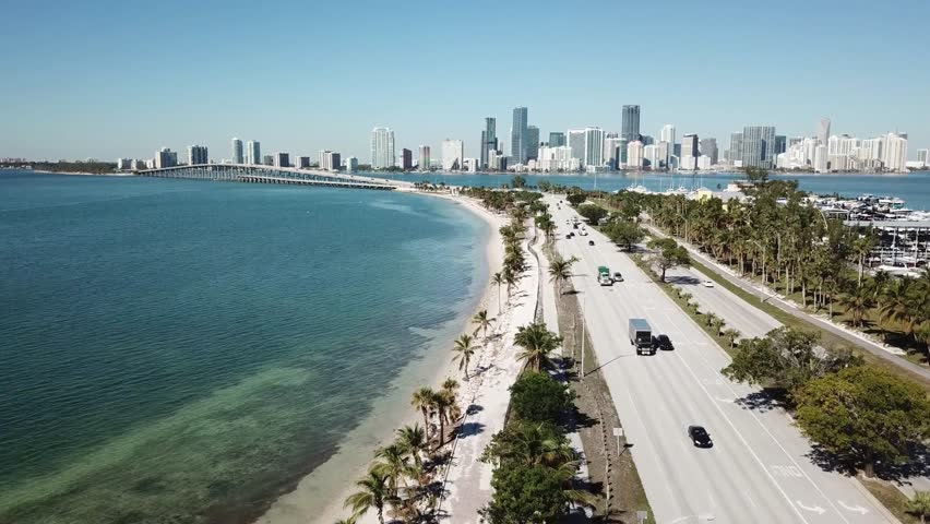 Wonderful aerial 4k drone panorama flight over huge highway road in big city Miami East Coast ocean coastline seascape