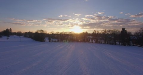 Drone sunset in snowy campain, beautiful winter sunset landscape