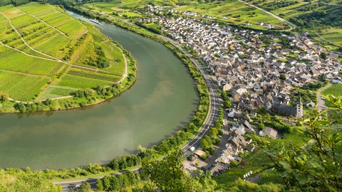 Timelapse sequence of a meander or riverbend of the Moselle River in the Eifel village of Bremm in Germany in summer. Seen from the Calmont vineyards.