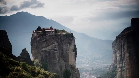 Cloudy sky over holy Trinity monastery on cliff in Meteora, Thessaly Greece. Greek destinations. Time lapse