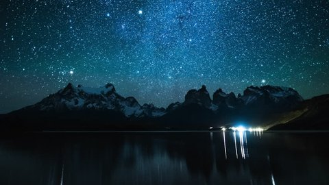 Torres del Paine National Park at night, timelapse with reflexion in the lake of Pehoe, Chile