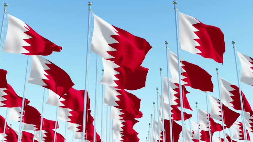 Many flags of Bahrain waving against blue sky. Three dimensional rendering 3D animation.