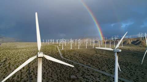 Aerial drone shot of a rainbow over the wind turbines in the San Gorgonio Pass by Palm Springs, California.