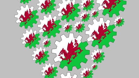 Gears with the welsh flag shaping heart zooming out