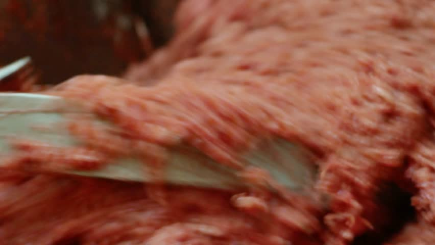 Processing of pork meat minced in a meat grinder. | Shutterstock HD Video #1008711526