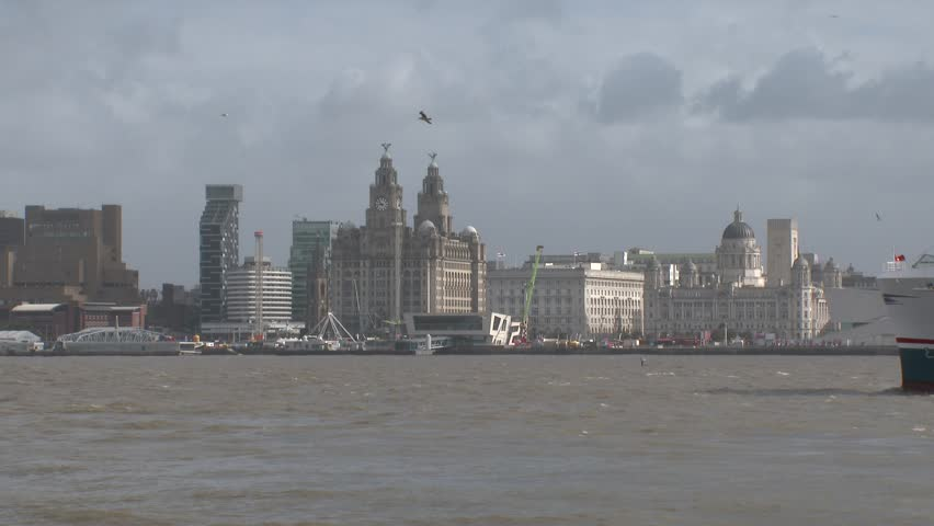 Liverpool, England, September 16, 2017.  A ferry travelling in the River Mersey passing the skyline of Liverpool in the background.