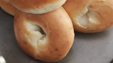 Fresh bagels closeup in daylight. HD video.