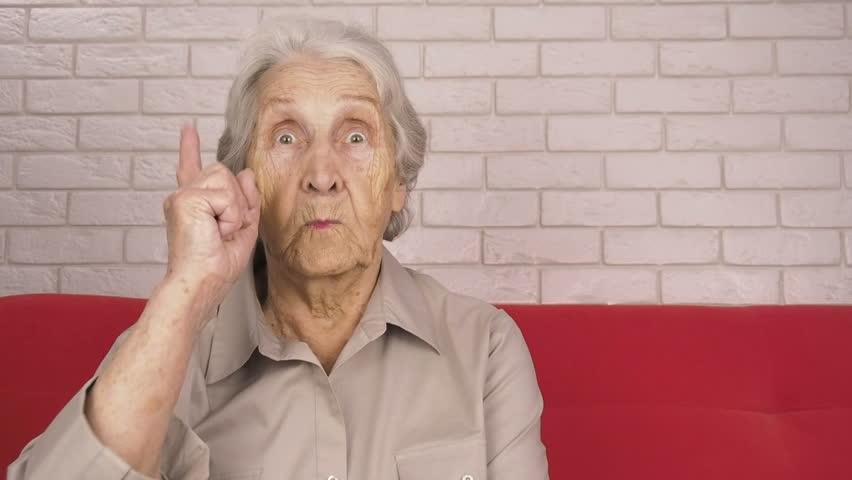Emotions of the elderly. An elderly woman swears.