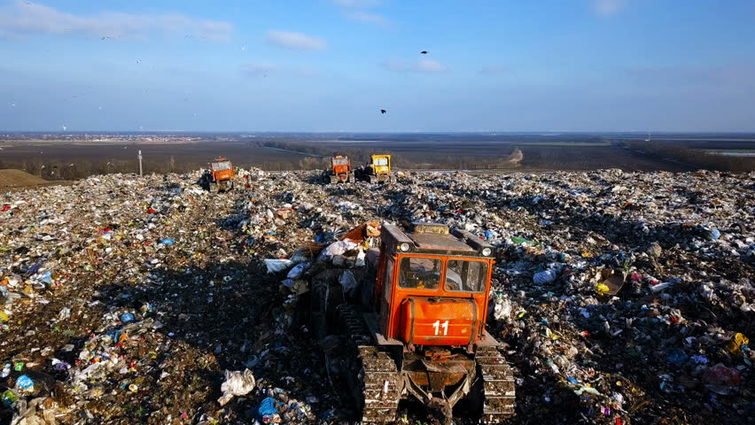 City Dump. The Bulldozer Compacts the Garbage on the Landfill. Wastes of Human Life. Aerial View | Shutterstock HD Video #1008733676