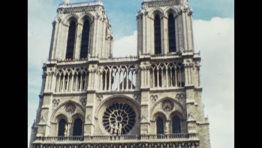 Paris 1970s: Notre Dame de Paris Cathedral in the French capital, on 1970s in Paris, France, Europe | Shutterstock HD Video #1008742016