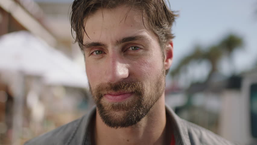 Close up portrait of attractive man smiling confident in beachfront background slow motion | Shutterstock HD Video #1008743876