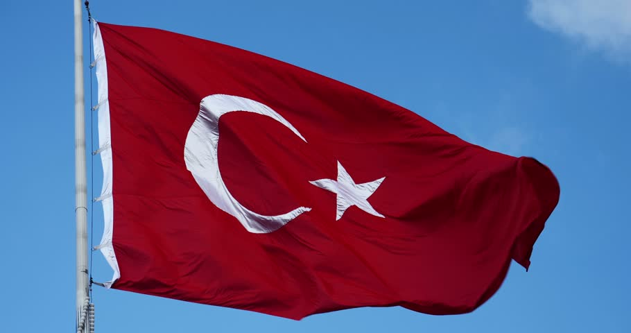 Real Turkish flag weaving on the wind on Taksim Square