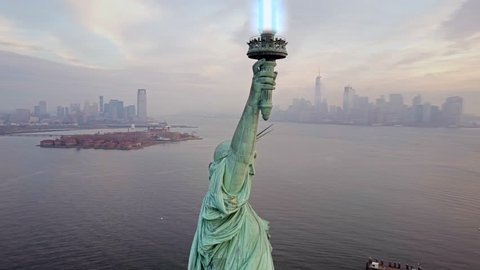 Aerial view of Statue of Liberty with Light saber 4k