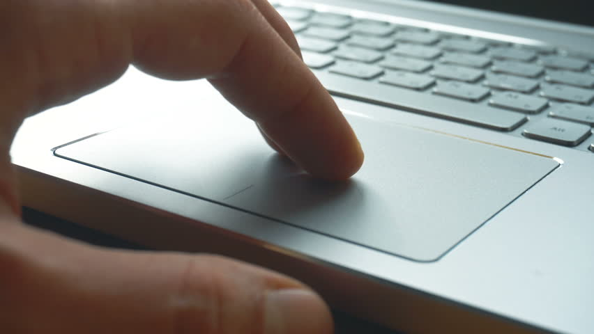 Laptop keyboard. Close up shot of man scrolling a Website Using Laptop Track Pad | Shutterstock HD Video #1008793376