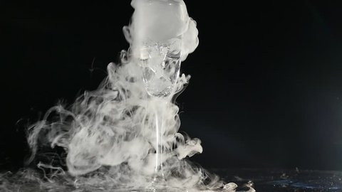 Boiling dry ice in a water with dense vapor