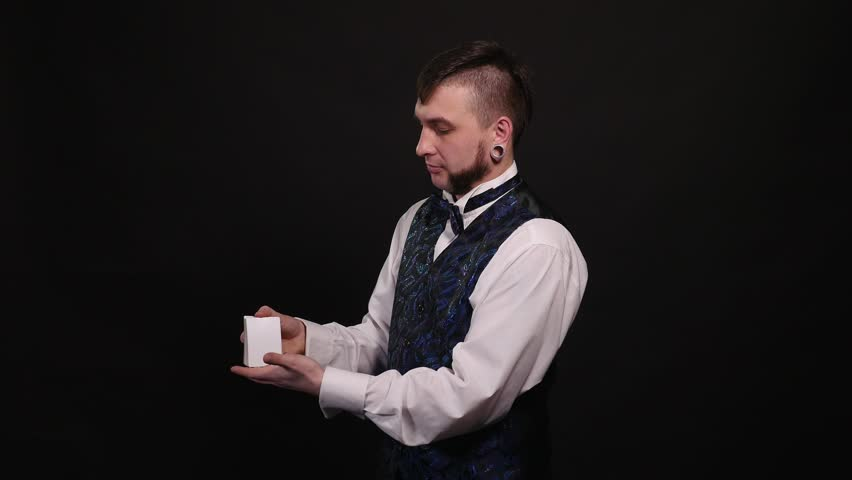 Magic, card tricks, gambling, casino, poker concept - man showing trick with playing cards | Shutterstock HD Video #1008822056