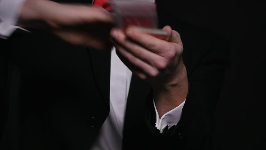 Magic, card tricks, gambling, casino, poker concept - man showing trick with playing cards | Shutterstock HD Video #1008822326