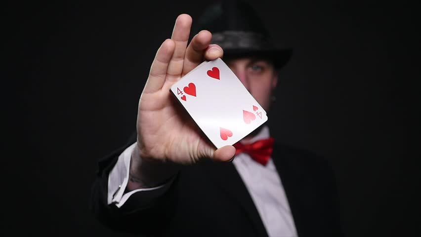 Magic, card tricks, gambling, casino, poker concept - man showing trick with playing cards | Shutterstock HD Video #1008822356