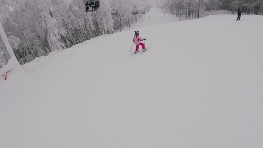 A little girl skiing in mountains, gopro footage | Shutterstock HD Video #1008834026
