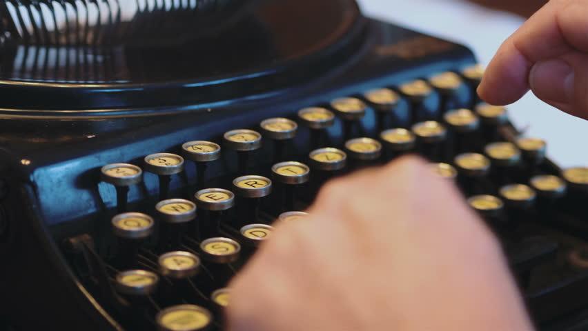 Professional video of senior man typing on an old typewriter in 4k slow motion 60fps