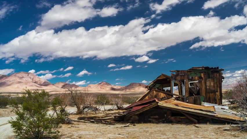 UltraHD cloudscape timelapse of a miner's abandoned and collapsed homestead in California's Mojave desert.