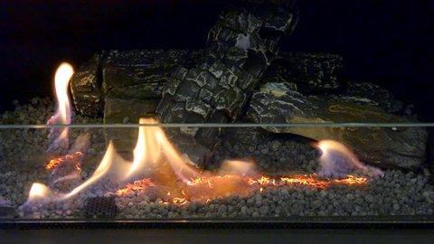 One Biofireplace burn on ethanol gas. Contemporary mount biofuel on ethanol fireplot fireplace close-up. Decorated bio fireplace. Modern smart ecological alternative technologies.