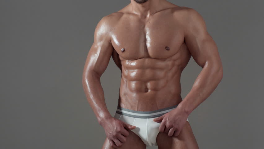 Sportsman, muscles, athlete man, triceps. Athletic caucasian, six pack, chest muscles, triceps. Beautiful male torso, ab. Biologically active additives. healthy eating.   Shutterstock HD Video #1008871586