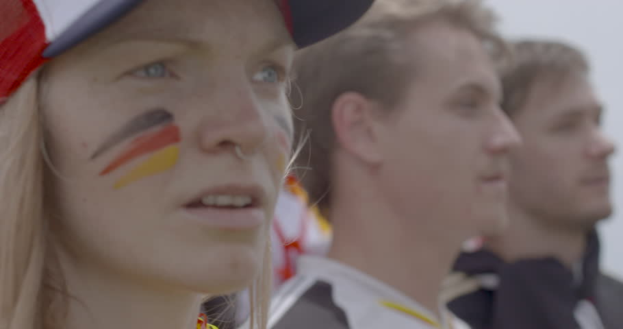 Sports enthusiast with painted face watching match attentively, slow motion | Shutterstock HD Video #1008892406