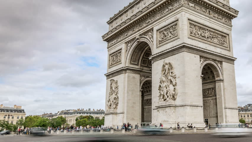 Arc de Triomphe in Paris. Car traffic. Cloudy sky. Time lapse video. Easy zooming in. | Shutterstock HD Video #1008893636