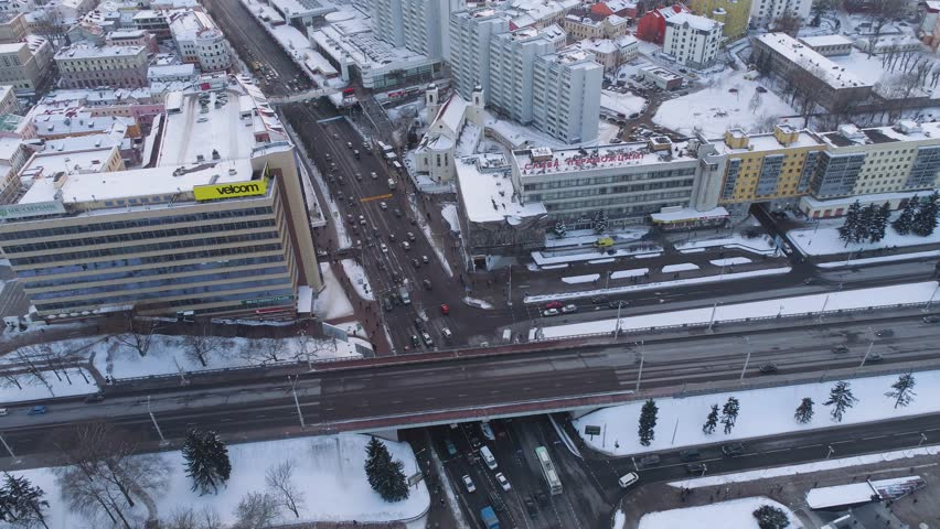 MINSK, BELARUS - FEB 2018: Winter aerial drone shot of the city centre snow sunny day from above residential and business buildings rooftops | Shutterstock HD Video #1008985226