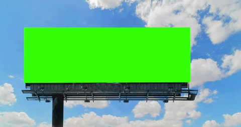 empty billboard with chroma key green screen, on blue sky with clouds time-lapse, advertisement concept