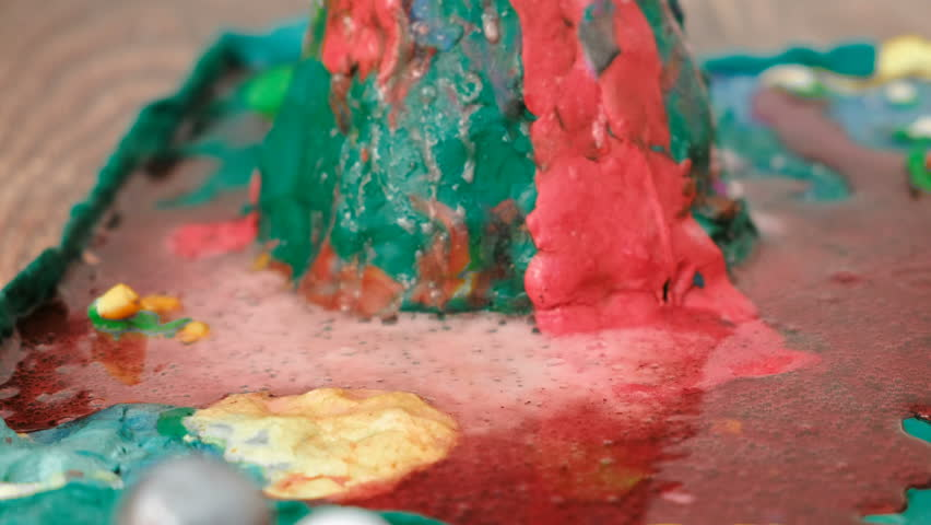 Closeup view of chemical reaction with gas emission. Experience with plasticine volcano at home.   Shutterstock HD Video #1009028816