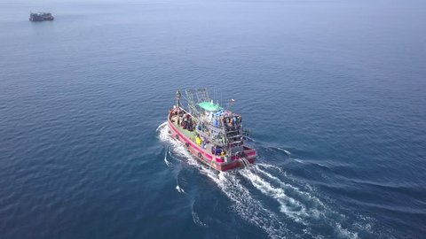 4k aerial drone view of a large fishing boat in open ocean off the coast of  the mergui archipelago in myanmar (burma)