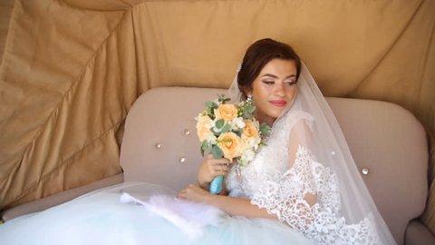 Happy Bride in the Wedding Carriage