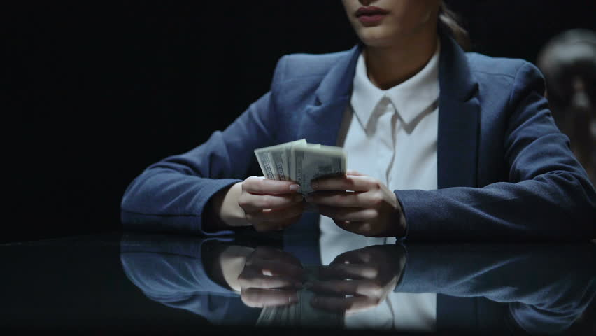 Woman reluctantly giving money to lawyer, extremely expensive legal services