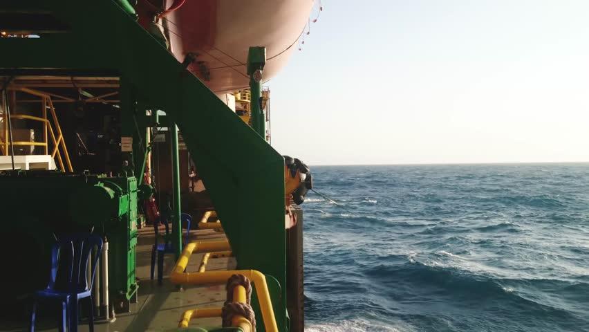 Tender Drilling Oil Rig (Barge Oil Rig) on The Production Platform at Twilight Time