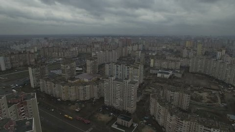 Aerial drone footage of gray dystopian urban area with identical houses