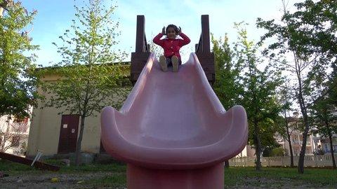 4K Girl slides down a chute