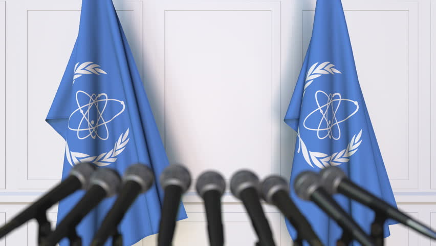 International Atomic Energy Agency IAEA official press conference. Flags and microphones. Conceptual editorial 3D animation