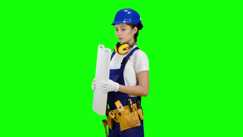 Girl in a helmet and a drawing in her hands is standing . Green screen | Shutterstock HD Video #1009240526