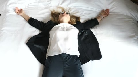 Exhausted Business Woman Falling Down On Bed Feeling Tired And Stressed