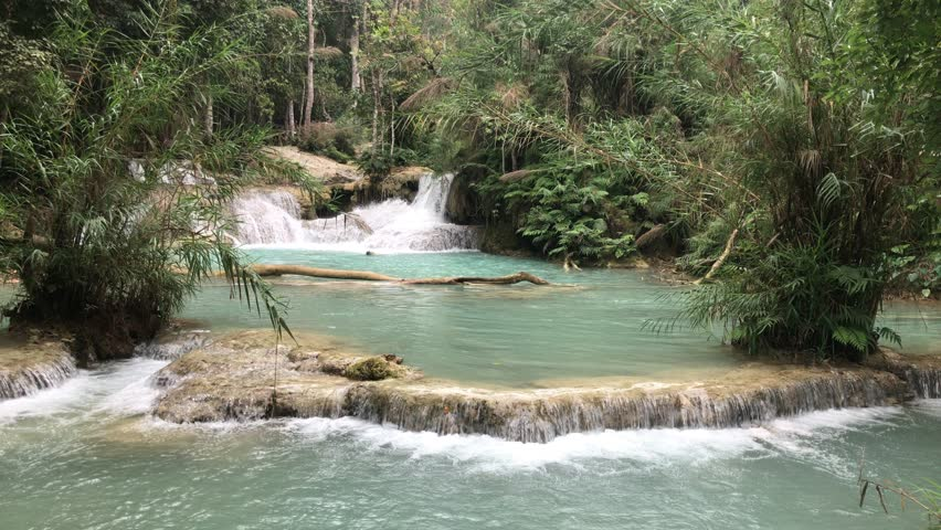 Kuang Si waterfall, or known as Tat Kuang Si, is a three tier waterfall about 29 kilometres in south of Luang Prabang. The best tourist attraction in Laos with emerald and crystal clear water.