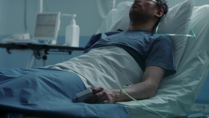 In the Hospital Sick Male Patient Sleeps on the Bed, Nurse Enters Medical Ward Checks His Vitals and Drop Counter. Sad and Blue Scene. Shot on RED EPIC-W 8K Helium Cinema Camera. | Shutterstock HD Video #1009295546