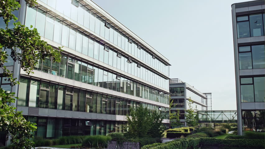 Video clip scrolling down contemporary campus building with glass windows.