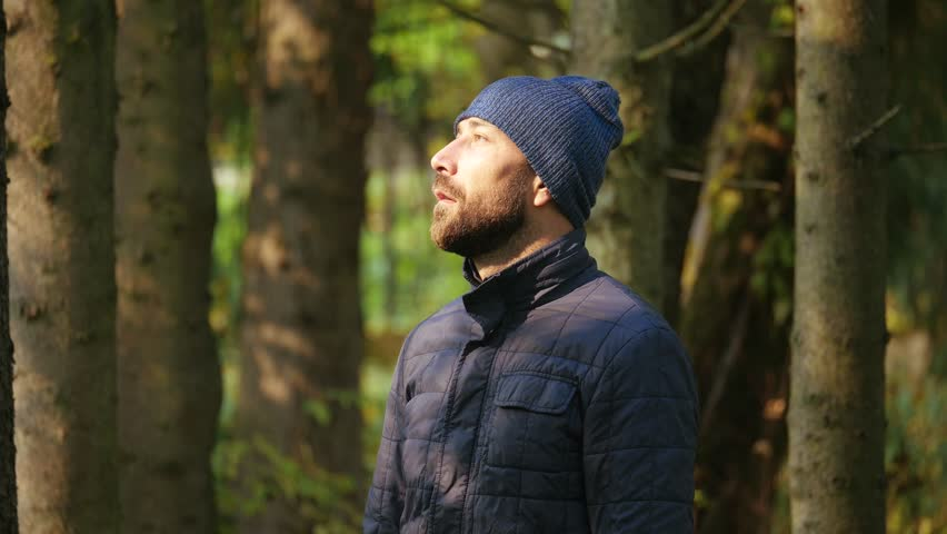 emotion nice person, expression and people concept - happy smiling man with beard in nature #1009359386
