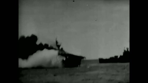 CIRCA 1940 - WW2 rough silent film clip of the Japanese bombing of the U.S.S. Franklin.