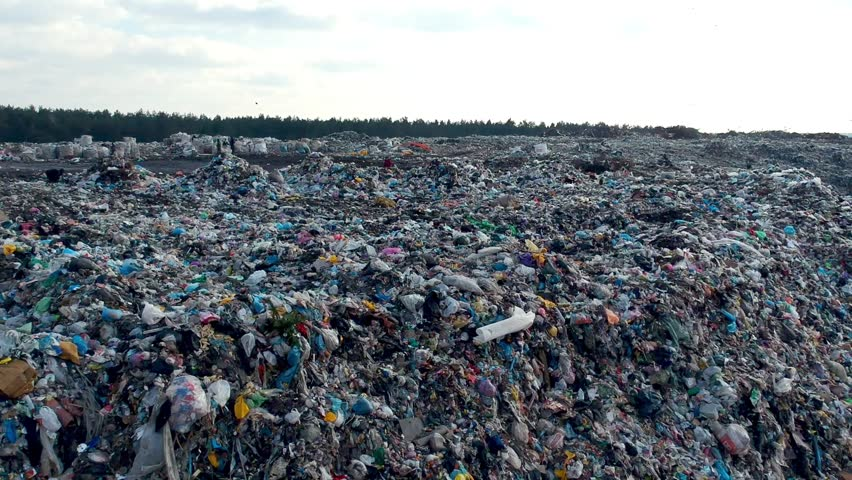 Aerial view on city garbage dump with birds  | Shutterstock HD Video #1009383326