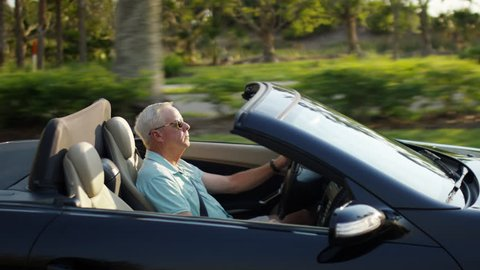 Active Senior Man Drives His Luxury Convertible In Sunny Florida - Shot On Red Scarlet-W Dragon In 4K/ Slow Motion